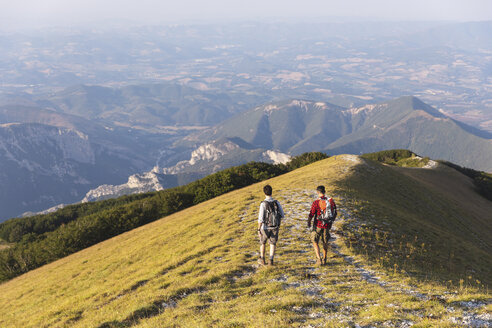Italy, Monte Nerone, two men hiking on top of a mountain in summer - WPEF01302