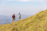 Italy, Monte Nerone, two men hiking in mountains in summer - WPEF01305