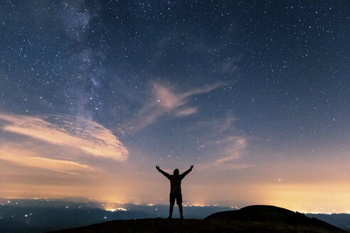 Italy, Monte Nerone, silhouette of a man looking at night sky with stars and milky way - WPEF01326