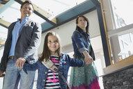 Daughter leading parents in airport - HEROF08013