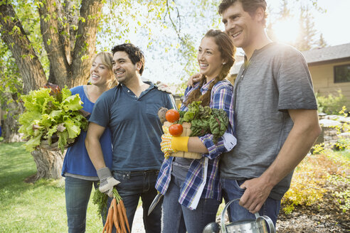 Couples holding freshly harvested vegetables - HEROF08037