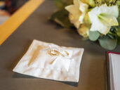Close-up of wedding rings on a white chushion - LAF02222