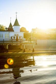 Germany, Usedom, Ahlbeck, sea bridge at sunset - PUF01355