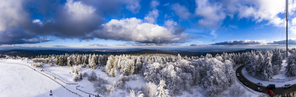Germany, Hesse, Taunus, Aerial view of road through coniferous forest in winter - AMF06735