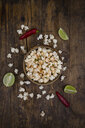 Bowl of popcorn flavoured with chili and lime - LVF07694