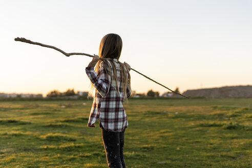 Back view of girl with stick in nature - ERRF00682