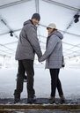 Couple standing at the ice rink - ZEDF01824