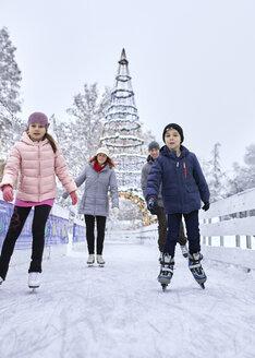 Serbia, Novi Sad, Ice skating, Family, Snow - ZEDF01839