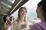 Women drinking wine together in restaurant - HEROF08128