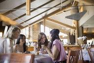 Women eating together in restaurant - HEROF08137