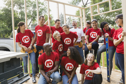 Smiling volunteers at construction frame - HEROF08173