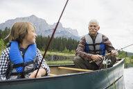 Older man and grandson fishing in lake - HEROF08224
