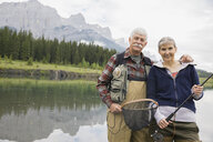 Older couple fishing in still lake - HEROF08272