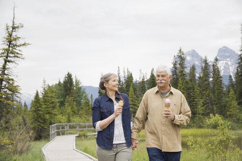 Older couple eating ice cream outdoors - HEROF08374