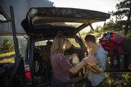 Couple camping, unloading SUV - HEROF08458