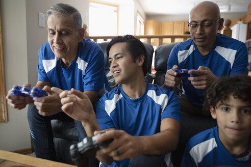 Latinx multi-generation family playing sports video game - HEROF08668