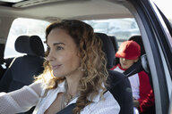 Latinx mother driving son to baseball practice - HEROF08680