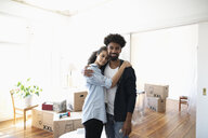 Portrait affectionate, confident couple moving into new home - HEROF08737