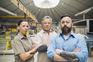 Serious workers in manufacturing plant - HEROF09021
