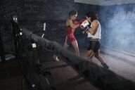 Tough female boxers training in boxing ring - HEROF09480