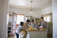 Family preparing breakfast in kitchen - HEROF09519