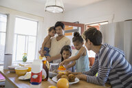 Family enjoying breakfast in kitchen - HEROF09522