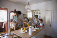 Family preparing breakfast in kitchen - HEROF09525