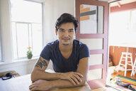 Portrait of smiling man in kitchen - HEROF09534
