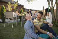 Homosexual couple hanging out at backyard barbecue - HEROF09549