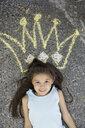 Portrait of girl with sidewalk chalk crown overhead - HEROF09567