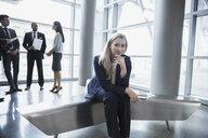 Portrait of confident businesswoman in lobby - HEROF09720