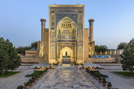 Exterior view of historic 15th century Madrasa building and courtyard at dusk. - MINF10138