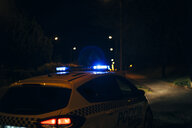 Spain, Madrid, police car with sirens on a road - OCMF00230