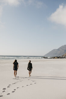 South Africa, Western Cape, Noordhoek Beach, two young women strolling on the beach - LHPF00404