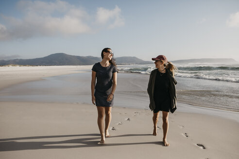 South Africa, Western Cape, Noordhoek Beach, two young women strolling on the beach - LHPF00407