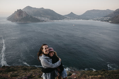 South Africa, Western Cape, two laughing women hugging each other - LHPF00416