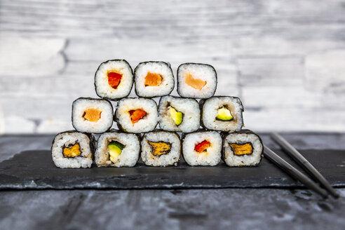 Stacked sushi on slate slab, chop sticks - SARF04070