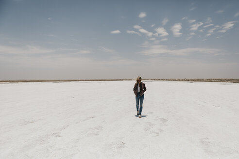 Namibia, Walvis Bay, woman walking on a salt plain - LHPF00422