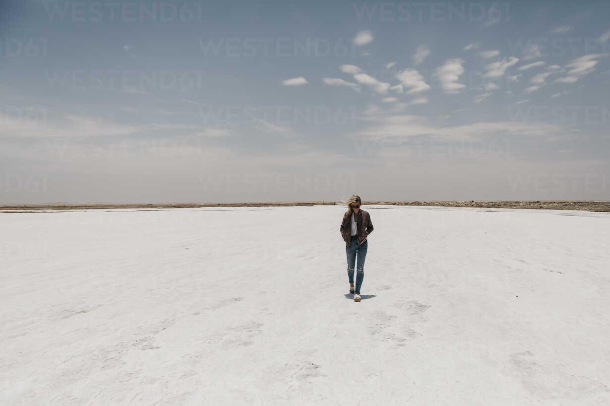 Namibia, Walvis Bay, woman walking on a salt plain - LHPF00422 - letizia haessig photography/Westend61