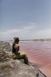Namibia, Walvis Bay, woman sitting at Pink Lagoons - LHPF00425