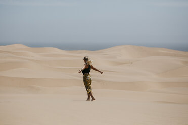 Namibia, Walvis Bay, Namib-Naukluft National Park, Sandwich Harbour, woman in dune landscape - LHPF00431