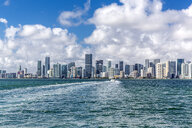 USA, Florida, skyline of Downtown Miami with motorboat on the water - MABF00519