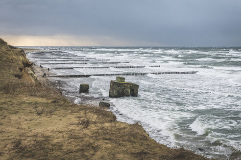 Germany, Mecklenburg-Western Pomerania, Fischland, Wustrow, Bunker in the Baltic Sea at storm - KEBF01046