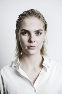 Portrait of blond young woman with wet hair - JESF00227