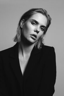 Portrait of blond young woman wearing black blazer - JESF00230
