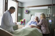 Wife visiting husband in hospital room - HEROF09781