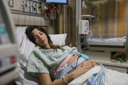 Sleeping pregnant woman in hospital bed - HEROF09790