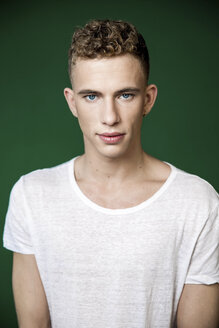 Portrait of confident young man wearing white t-shirt in studio - VWF00068