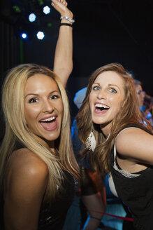 Portrait of enthusiastic women dancing in nightclub - HEROF10126