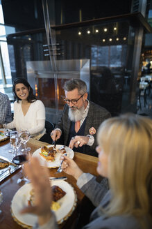 Business people dining at restaurant table - HEROF10911
